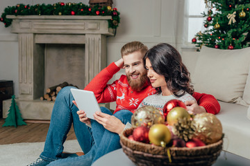 couple using tablet on christmas