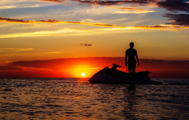 Foto op Canvas Water Motor sporten silhouette of a man on a jet ski in the sun
