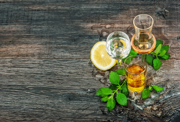 Drinks with ice lemon mint leaves wooden background