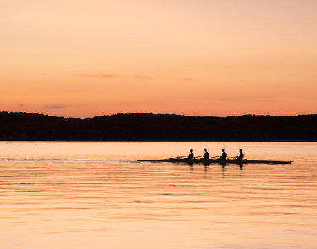 rowing on the sea at sunset