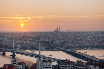 Istanbul sunset panorama - Turkey travel background. Profile view golden horn in Istanbul at sunset, high contrast with mosque in the skyline