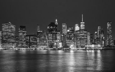 Black and white picture of Manhattan skyline at night, New York City, USA.