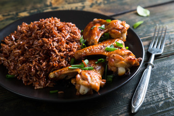 Fried chicken wings and red rice