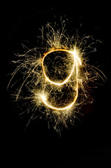 """""""9"""" number drawn with bengali sparkles isolated on black backgroundnumber from sparkler on black background"""