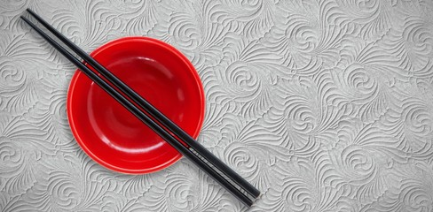 Composite image of close up of chopstick and bowl