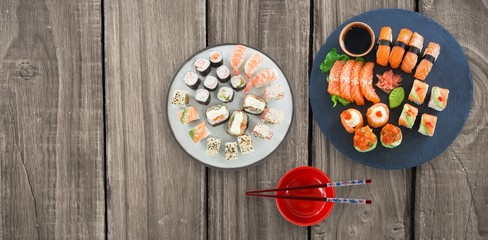 Composite image of high angle view of sushi with sauce