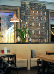 Elements of the interior of a cozy cafe. Good mood. Blurred background. Interior decor