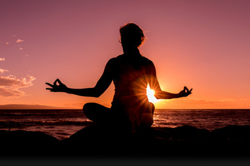 Woman Practicing Yoga at Sunset on a Maui Beach