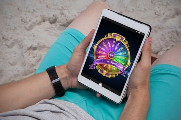 Composite image of colorful wheel of fortune on mobile display