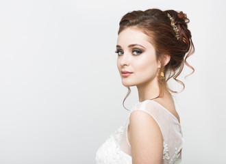 Young pretty caucasian bride in wedding dress