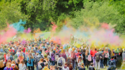 Celebrants dancing during the color Holi Festival. Holi festival with colorful hands, vivid powder, selective focus