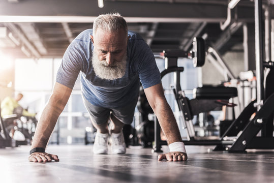 Mature man doing workout in athletic club