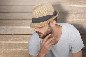Composite image of handsome man wearing hat