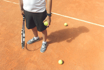Teenager ready for play on court