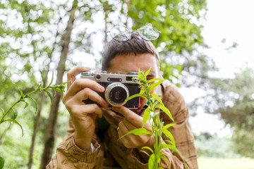 Image of man with camera in woods