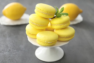 Canvas Prints Macarons Dessert stand with tasty homemade lemon macarons on table