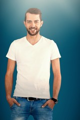 Composite image of smiling fashion model with hands in pockets