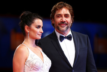 "Actors Penelope Cruz and Javier Bardem pose during a red carpet event for the movie ""Loving Pablo"" at the 74th Venice Film Festival in Venice"