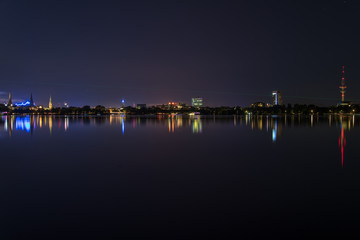 nightly panorama of Hamburg - Inner City with laser beam