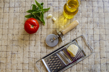 Pizza ingredients and cutter