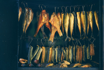 Foto op Canvas Vis Fish Smoking Process, marine fish in smokehouse
