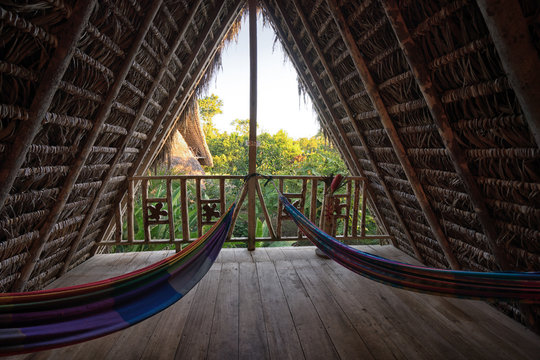 hammocks in eco lodge built from bamboo in the jungle
