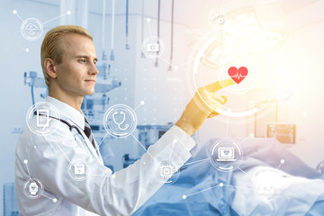Smart healthcare technology concept. Doctor point finger and blur operation room background in hospital with icons graphic. Blue tone image and flare light effect.