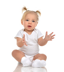 Infant child baby boy toddler holding imaginary object in hands fingers up on a floor
