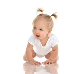 Infant child baby girl toddler crawling happy looking at the corner