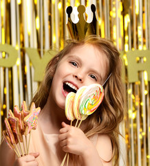 Little girl kid hold ginger candy lollipops on birthday party happy smiling