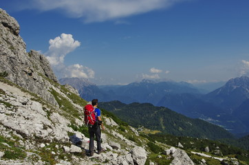 Young man hiking in the Dolomites