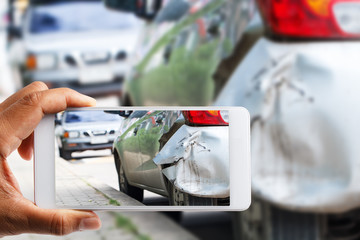 Car insurance agents take pictures of accident