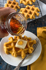 Pouring Maple Syrup on Pumpkin Waffles