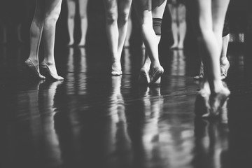 legs of young dancers ballerinas in class classical dance, ballet , Thailand