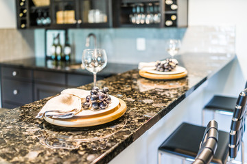 Grapes on plate of modern granite kitchen bar in luxury apartment or restaurant