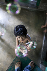 Baby girl playing with soap bubble