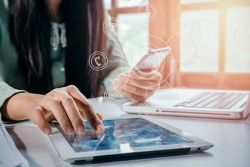 Businessman hand using smart phone