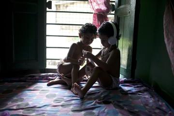 Twin girls browsing smartphone