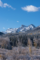 Coxcomb Peak viewed from Cimarron River Valley after early fall snow storm. Located in the Uncompahgre National Forest, Colorado.