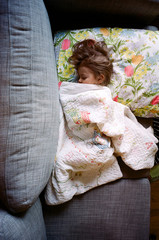 little girl napping on couch