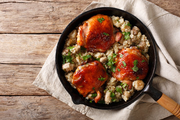 Natural Food: Baked chicken thighs with quinoa and mushrooms close up. horizontal top view