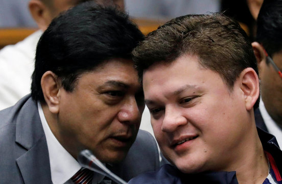 A lawyer whispers to Paolo Duterte, Davao's Vice Mayor and son of President Rodrigo Duterte, during a Senate hearing on drug smuggling in Pasay, Metro Manila