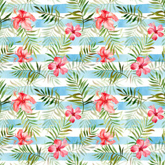 Seamless pattern with watercolor tropical flowers and leaves on striped background.