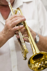 Hands of the musician playing a trumpet closeup