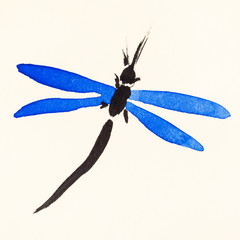 dragonfly with blue wings on cream colored paper
