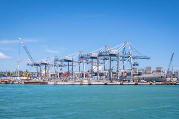 Auckland port with shipping containers, cranes and ship in New Zealand, NZ