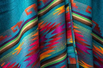 colorful textile closeup in Otavalo artisan market Ecuador