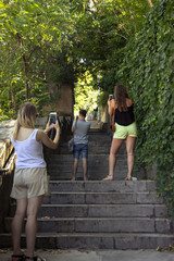Three young people photographed the stairs and each other