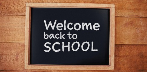 Composite image of welcome back to school text against white