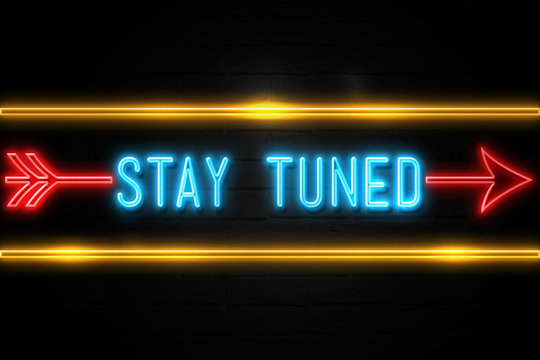 Stay Tuned  - fluorescent Neon Sign on brickwall Front view